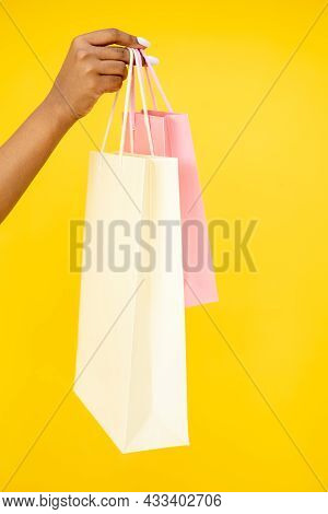 Shopping Purchase. Black Friday. Sale Discount. Closeup Of African Woman Hand Holding Mall Shopper B