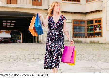 Young And Happy Shopper With Colorful Reusable Paper Bags. Black Friday Sales Season.