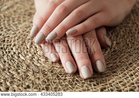 Matt Nude Beige Nails Close Up. Winter Or Autumn Manicure On Woman Hand