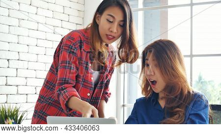 Asian Colleague Friendship At Work With Smiling Face. Happiness Two Women Colleague Working Together