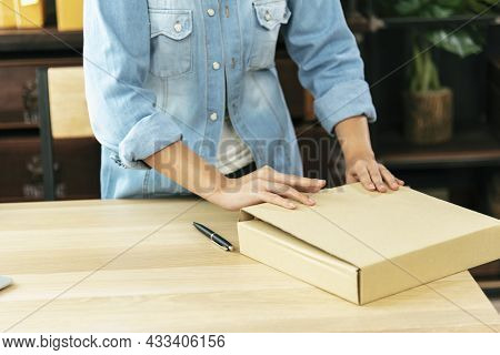 Woman Packing Box On Table Checking Goods Package Delivery Shipping To Customer. Asian Woman Startup
