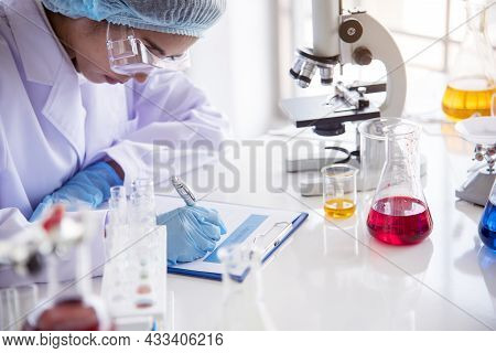 Woman Scientist In Lab Look At Science Microscope Medical Test And Research Biology Chemistry. Femal