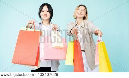 Shopaholic Lifestyle. Happy Women. Hot Sale. Best Offer. Shopping Discount. Pretty Smiling Asian Cau