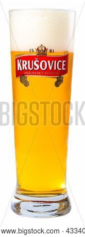 Uzhgorod, Ukraine - Sep 02, 2015: Glass Of Beer With Krusovice Label. Yellow Alcohol Drink With Foam