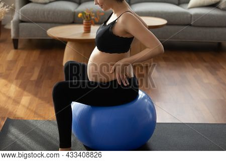 Future Mum In Sportswear Practice Gymnastics For Pregnant On Fitball