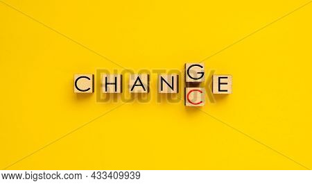 Changing The Word Change Into Chance. Wooden Dices Spelling Words Change And Chance.