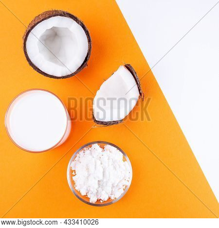 Coconut Milk In Powder And Dissolved With Water In A Glass, Lactose Free Milk On Orange And White Ba