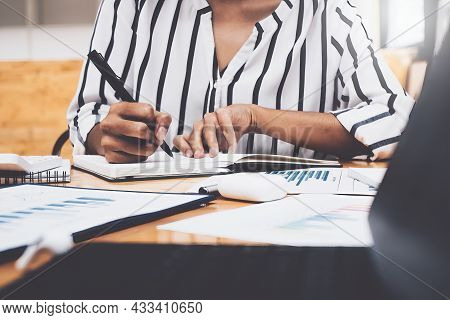 Business Woman Working To Analyze Technical Price Graph And Indicator