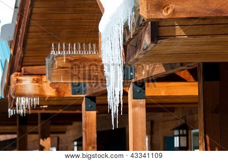 Icycles Hanging Off Cedar Roof