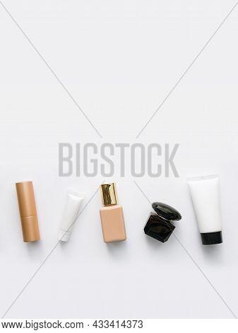 Vertical Flatley Background: Lipstick, Eye Cream, Foundation, Perfume And Moisturizing Face Mask. On