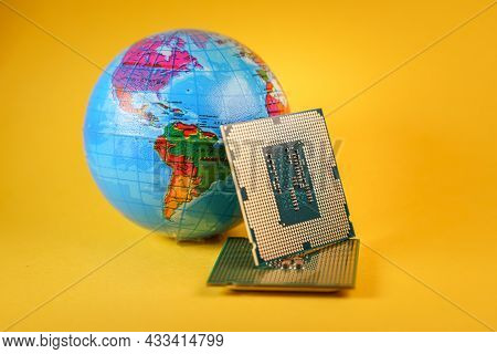 World Globe And Microprocessors Against An Orange Background
