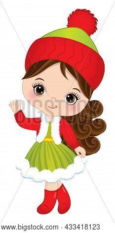 Cute Little Girl Wearing Winter Dress, Jacket And Knitted Hat. Little Girl Is Brunette With Hazel Ey