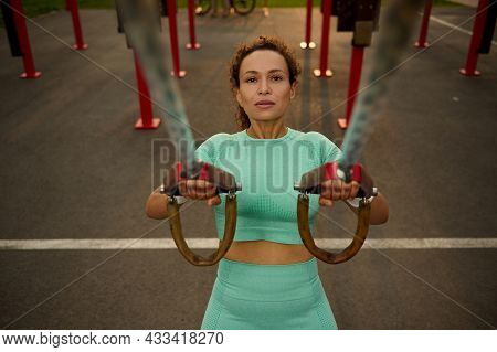 High Angle View Of A Sporty Determinate Middle Aged African American, Mixed Race Woman Doing Arm Exe