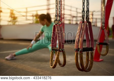 Soft Focus On Suspension Straps In The Summer Outdoor Sportsground On The Background Of Blurred Dete