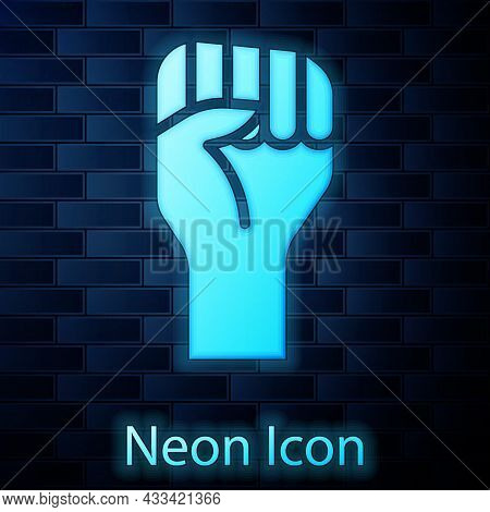 Glowing Neon Raised Hand With Clenched Fist Icon Isolated On Brick Wall Background. Protester Raised
