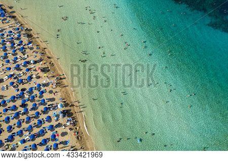 Aerial Drone Photograph Of Fig Tree Bay Beach. With Tourists Relaxing And Enjoying Summer Vacations