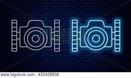 Glowing Neon Line Photo Camera For Diver Icon Isolated On Brick Wall Background. Foto Camera Icon. D