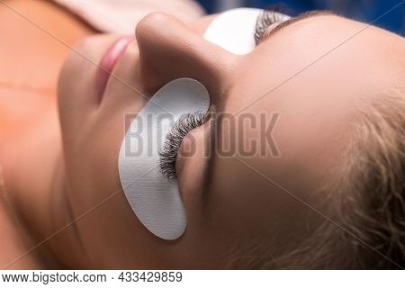 Woman With Long Lashes In A Beauty Salon. Eyelash Extension.