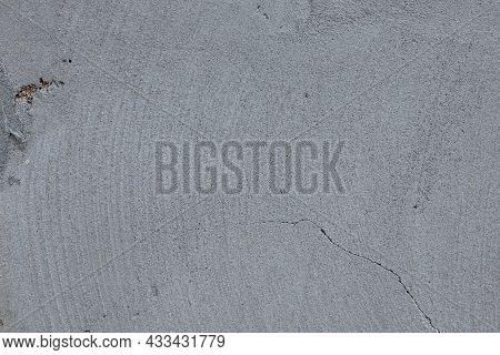 Plastered Gray Wall  Texture. Gray Wall Background. Front View With Copy Space.