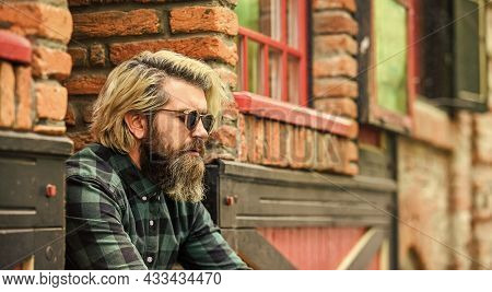 Bearded Man Checkered Shirt. Hipster Dyed Hair And Beard. Hairdresser And Barbershop. Brutal Male Wi