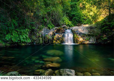 Beautiful Water Stream In Poço Da Cilha Waterfall, Manhouce, Sao Pedro Do Sul, Portugal. Long Exposu