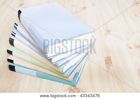 Colorful Bookstack On Wooden Floor