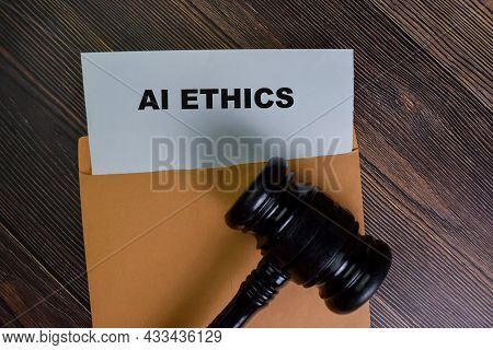 Ai Ethics Text On Document Above Brown Envelope.