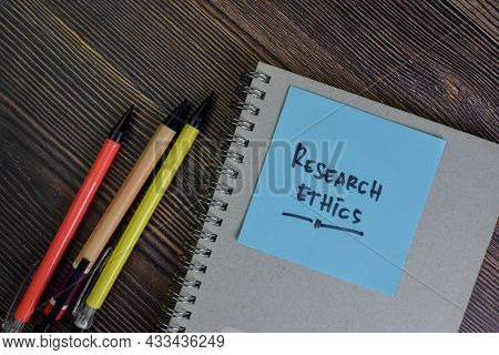 Research Ethics Write On Sticky Notes Isolated On Wooden Table.