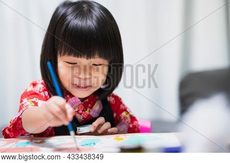Happy Asian Child Painting Water Color On Paper Art. Sweet Smile Girl With Lesson In Class At Homesc