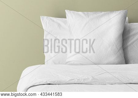 Pillow on bed with blank copy space