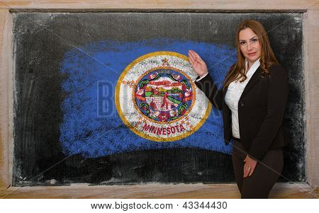 Teacher Showing Flag Ofminnesota On Blackboard For Presentation Marketing And Tourist Advertising