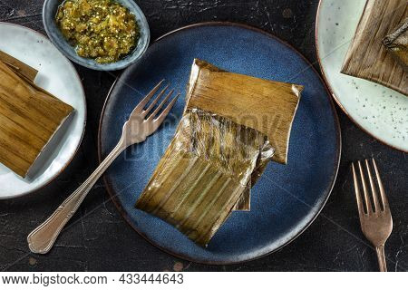 Tamal, Traditional Dish Of The Cuisine Of Mexico, Various Stuffings Wrapped In Green Leaves. Hispani
