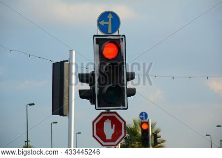 Red Traffic Light And Go Straight Or Left And Stop Signs. Mandatory And Prohibitory Signs. Road Sign