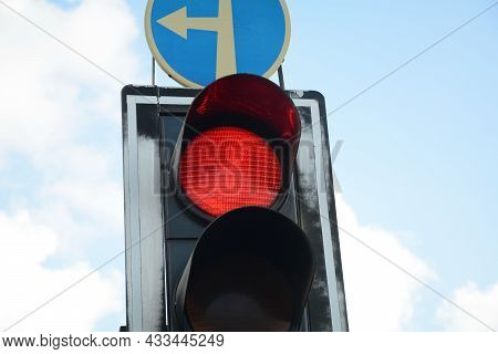 Red Traffic Light And Go Straight Or Left Sign. Mandatory Signs. Road Signs In Israel