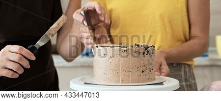 Women Couple Making Chocolate Cake In Kitchen, Close-up. Cake Making Process, Selective Focus, Banne