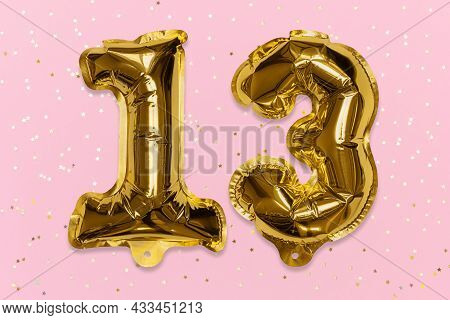 The Number Of The Balloon Made Of Golden Foil, The Number Thirteen On A Pink Background With Sequins