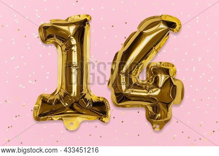 The Number Of The Balloon Made Of Golden Foil, The Number Fourteen On A Pink Background With Sequins