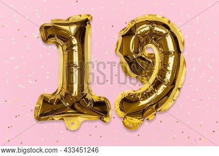 The Number Of The Balloon Made Of Golden Foil, The Number Nineteen On A Pink Background With Sequins