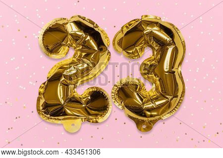The Number Of The Balloon Made Of Golden Foil, The Number Twenty Three On A Pink Background With Seq