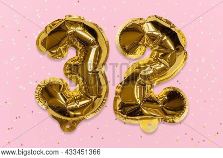 The Number Of The Balloon Made Of Golden Foil, The Number Thirty Two On A Pink Background With Sequi