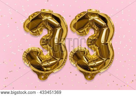 The Number Of The Balloon Made Of Golden Foil, The Number Thirty-three On A Pink Background With Seq