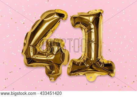 The Number Of The Balloon Made Of Golden Foil, The Number Forty-one On A Pink Background With Sequin