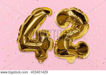 The Number Of The Balloon Made Of Golden Foil, The Number Forty-two On A Pink Background With Sequin