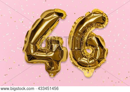 The Number Of The Balloon Made Of Golden Foil, The Number Forty-six On A Pink Background With Sequin