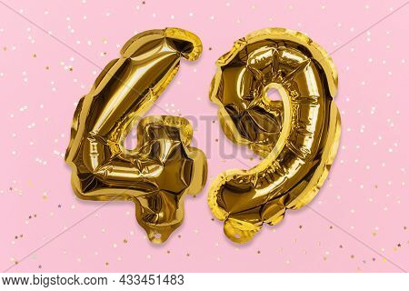 The Number Of The Balloon Made Of Golden Foil, The Number Forty-nine On A Pink Background With Sequi