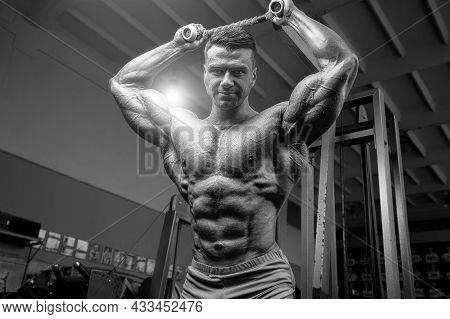 Old Fashion Bodybuilder Arm Exercises In Gym.