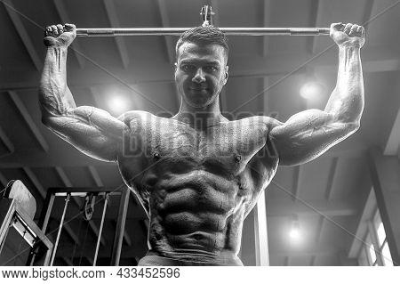 Old Fashion Bodybuilder Exercises In Gym.