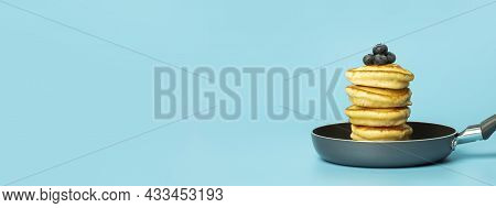 Pancakes With Berries On A Blue Banner Background. Lush Delicious Pancakes With Blueberries And Syru