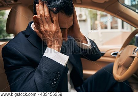 Businessperson Adjusting His Haircut In Car Cabin
