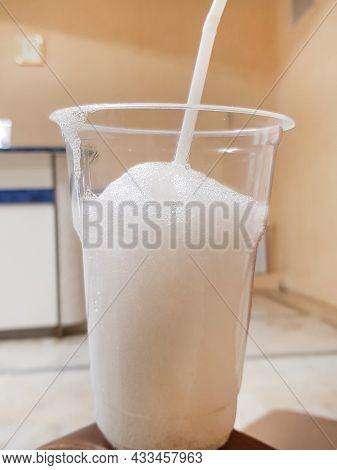 Transparent Glass With Foam And Oxygen Cocktail With A Straw, Vertical Photo.